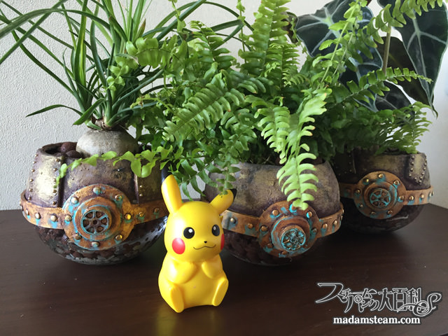 Steampunk poke ball planter